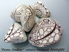 Zentangle on white rocks.  Beautiful!