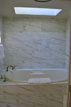 """Thinking of bathroom remodel gray tile? Do something! Impact Remodeling is the Scottsdale bathroom remodeling Contractor of choice known for their """"no pressure"""" approach. Impact Remodeling is known for artisan craftsmanship, attention to detail, and professional work that is fully licensed, bonded, and insured for general contracting in the State of Arizona (ROC# 298594). Contact them by calling: (602) 451-9049 or clicking this image. Mention Pinterest for 10% off!"""