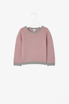 Made from pure knitted cotton with a soft interior, this jumper has a raised two-tone knit with a tactile textured fine. A comfortable relaxed fit, it has block-colour ribbed edges and a simple round neckline.