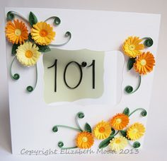 A card for reaching 101 years using quilled frilly flowers