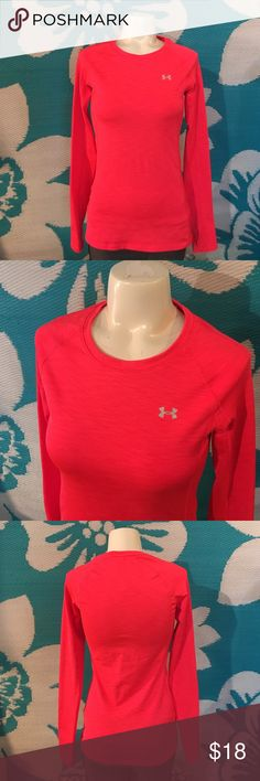 "UNDER ARMOUR LONG SLEEVE UA Heat Gear, long sleeve, excellent condition! No flaws! Color is a bright orange! Size xsmall.  I value the trust it takes to purchase merchandise off the Internet from a complete stranger's closet and will personally guarantee your satisfaction! Check out ""Love Notes"" in my ""About"" section for references. I do not trade but reasonable offers are welcome! Thanks! Under Armour Tops"