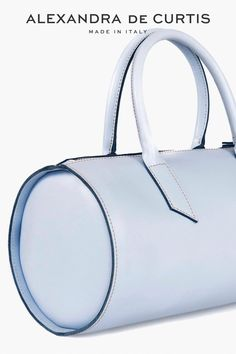 The Gio Barrel Bag is our updated and feminine twist on this classic women's bag. Luxuriously modern thanks to its sleek design; cylindrical shape, soft leather and clean lines, this Midi size bag is ideal for everyday wear. You and your Gio are bound to turn heads on your next trip to the yoga or pilates studio. Why not channel the sporty-chic trend in luxurious style? Italian Leather Handbags, Designer Leather Handbags, Tote Handbags, Tote Bags, Soft Leather, Leather Bag, Barrel Bag, Pilates Studio, How To Make Handbags