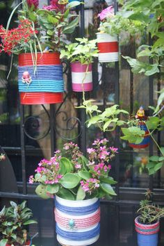 painted can as flower pots : refreshing and easy!
