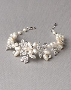 Glistening freshwater pearl bridal bracelet features freshwater pearl flowers accented with rhinestone encrusted leaves. Bridal Bracelet, Bridal Necklace, Bridal Jewelry, Beach Wedding Jewelry, Wedding Bracelets, Freshwater Pearl Bracelet, Pearl Jewelry, Ankle Bracelets, Jewelry Bracelets