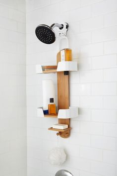 13 Ideas For Creating A More Manly Masculine Bathroom // Keep all the shower products organized in style with a wood shower caddy.