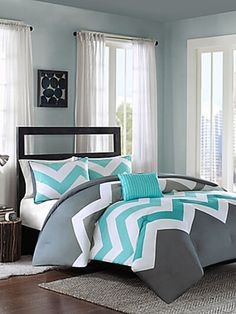 Add a pop of color to your bed with the eye-catching Cade Reversible Comforter Set. Decked out in an aqua and grey chevron design and solid grey reverse, the bold bedding is a fun and funky addition to any bedroom. Grey Bedroom With Pop Of Color, Cool Kids Bedrooms, Bedroom Makeover, Comforter Sets, Bedding Sets, Bedroom Sets, Bedroom Decor, Bedroom, Home Decor