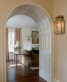 Fabulous arched doorway with raised panels. Anne Decker Architects