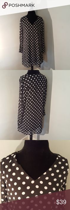 """NWT Neiman Marcus Black & White Polka Dot Dress NWT Neiman Marcus Black & White Polka Dot Dress. Interesting split sleeve, see 4th photo. I love this dress, it's just a little too short on me for work at 6' tall in an academic position! Length from shoulder 35.5"""" Never worn, perfect condition. See photos for tags with more information. Comes from pet and smoke free loving home. Neiman Marcus Dresses"""