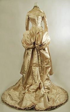 Huh. Apparently once upon a time, a bride's greatest wish was to make her backside look huge. (back view of an early 1870s wedding dress, American)