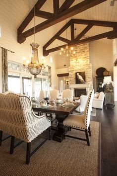 2013 Southern Living Showcase House - Cottage dining room with rustic wood beams in vaulted ceiling.