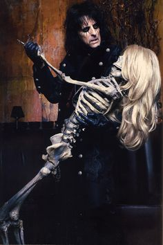 "Alice Cooper-  ""Yeah ooh oh one thing I miss is cold Ethyl and her skeleton kiss  ........Ah one thing no lie Ethyl's frigid as an Eskimo pie  She's cool in bed she's gotta be 'cause Ethyl's dead"""