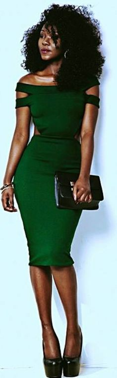 Emerald pencil, shoulderlength tightly curled black hair