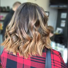 Beautiful balayage bob haircut. Formulated using Redken color and Redken styling products.