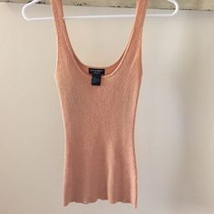 Guess top Great condition guess fitted top color is a peachy color with gold Guess Tops