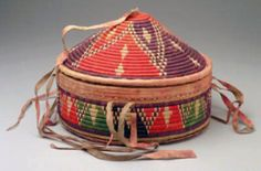 Africa | Basket from Ethiopia; plant fiber, leather, dyes | 20th century