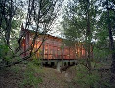 Texas bunkhouse accommodates natural contours of the land. by Henry Panton.