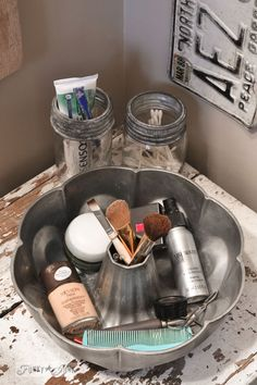 Antique cake pan and mason jars for makeup storage / A little new old upcycled bathroom organizing via http://www.funkyjunkinteriors.net/