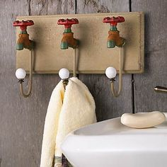 wall hooks made from old wooden blocks | Vintage Faucet Wall Hooks | Wild Wings