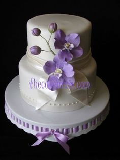 Orchids cake.... are also hand-molded out of sugar-paste - We love and had to share! Great #CakeDecorating