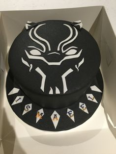 Marvel Black Panther Cake 8-inch vanilla sponge cake with vanilla buttercream. Covered with fondant.