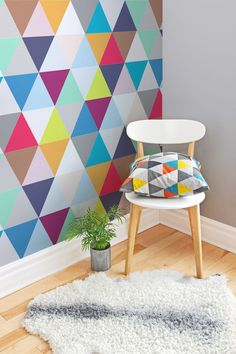 If you love geometric prints, you'll love this colourful wallpaper design. It makes a fun and quirky accent wall in the living room. Team with minimal furnishings to really make the wallpaper pop! Wallpaper for the wall design and ideas Geometric Triangle Wallpaper, Geometric Wall Art, Colorful Wallpaper, Geometric Prints, Wall Wallpaper, Bedroom Wallpaper, Trendy Wallpaper, Wallpaper For Living Room, Playroom Wallpaper