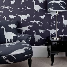 D'ya-think-e-saurus boys dinosaur wallpaper purple chair and lampshade  contact www.rhainteriors.co.uk