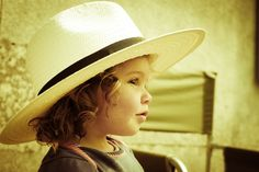 .Love the hat, and the curls on this adorable little girl