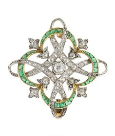 FRENCH EMERALD AND DIAMOND BROOCH.
