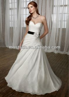 white wedding dress with a black belt and white flower
