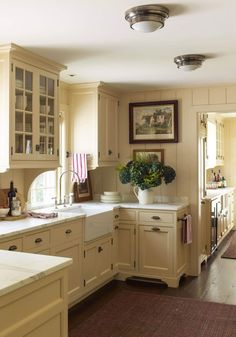 A Charming Connecticut Farmhouse by Gil Schafer - ***brackets below glass front cabs Kitchen Redo, Kitchen Styling, New Kitchen, Vintage Kitchen, Kitchen Ideas, Awesome Kitchen, Kitchen Cabinets With Feet, Cream Kitchen Walls, Cream Cupboards