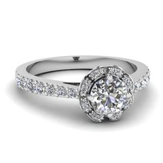 Shop round cut diamond engagement ring in 14K white gold at Fascinating Diamonds. This Affordable Engagement Rings can be customized as per your desire.