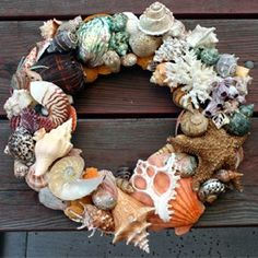 Just Gorgeous ❗An all natural multi shell wreath - I think I could do this, as I have enough found shells, but would need an enormous amount of hot glue to put it together.