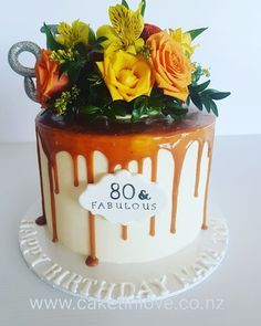 "8"" chocolate cake covered in white ganache with a yummy caramel drip"