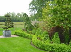Formality on Modern Estate by Claudia de Yong Designs www.claudiadeyongdesigns.com and www.thegardenspot.co.uk
