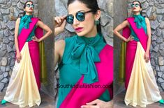 At a recent Pause For A Cause Event, actress Shilpa Reddy wore a color blocked saree by Mrinalini. The pink and half white saree was paired up with a stylish turquoise high neck bow-tie blouse with a matching pair of shoes. For her make-up look, she went with bold pink lips and accessorized with blue earrings and mirror reflectors. She looked good!