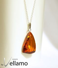 Sterling silver necklace with natural Baltic amber, cognac color with inclusions $16