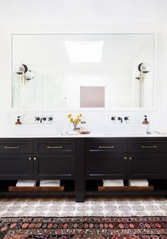 Master bathroom with black vanity in a California eclectic home.