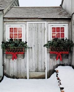 Winter window boxes & urns. I would love to put these boxes on the side windows. I would also love a shed just like this and do this to it.