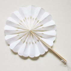 Rosette Folding Paper Fans (Event Blossom EB2355)   Buy at Wedding Favors Unlimited (http://www.weddingfavorsunlimited.com/rosette_paper_fans.html).