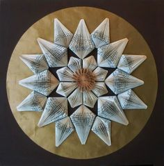 This mandala-like paper sculpture by Clara Maffei must be quite large. It would make a fantastic focal point for a home office or library.