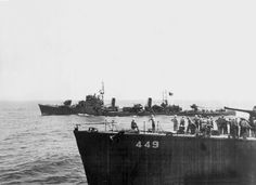 """Port side view of the Japanese destroyer Hatsuzakura, seen across the bows of the U.S. Navy destroyer USS Nicholas (DD-449). The Japanese ship was bringing officers and harbour pilots to a conference off Japan aboard the battleship USS Missouri (BB-63) with members of Admiral William F. Halsey's staff. The 12 cm guns of her main armament are at full depression and unmanned."""" CV-16"""