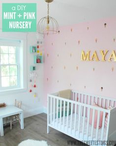 A bright and cheerful girls nursery with pink, mint and gold colour scheme.
