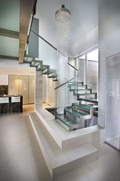 St. Maarten Villa by Vanessa DeLeon -- Amazing stair design over a water feature !