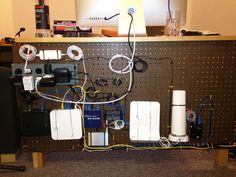 How To Use a Pegboard to Control Desk Wires and Cables    http://www.apartmenttherapy.com/control-desk-wires-with-pegboard-183139
