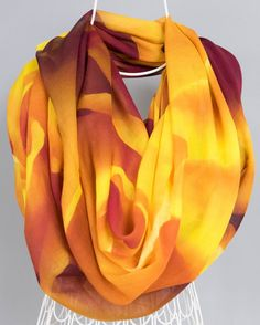 Inspired by the orange and yellow tones that gave this lovely rose its overall golden hue, I photographed it and created an abstract design that would accentuate this by using the lines of the petals to draw the eye in.  So soft, light and airy - you will love this modern, casually sophisticated scarf.  Works nicely as a light wrap. Perfect for a wedding bridal party.   Details: Measures - 80 Length x 30 Width Colors - Shades of Gold, Yellow and Reds Fabric - 100% Modal   Questions/comme...