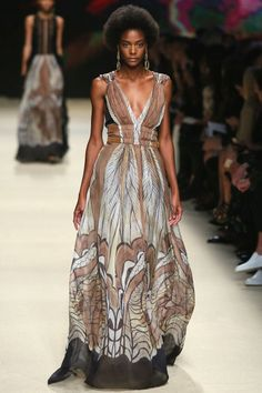 Neutral browns and tans grounded all the breezier moments, and a beautiful abstract earth print felt tribal and raw and worked beautifully on a long gown cinched at the waist. And yes, these would work nicely at any of the summer fests...