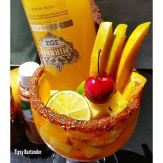 Smirnoff Punch  A glass rimmed with Chamorro and takin Ice 1/3 cup of mango juice 1/3 cop of pineapple juice 1oz Tequilla Fresh mango Frozen pineapple squares Lime wedges Orange wedges Cherry Schmirnoff (screwdriver) Tamarind Pulp Lollipop or a regular straw