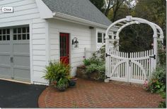 Detached Garage with sweet arched white picket garden gate...I ❤ the lantern too!