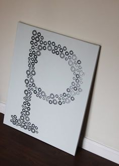 Initial on canvas made from various sized washers