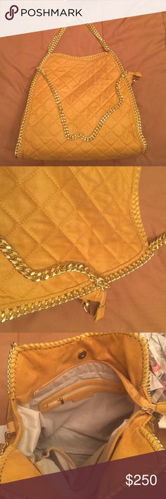 Stella McCartney bag Beautiful gold & yellow Stella McCartney bag! Large size. Brand new never used no flaws! Non-authentic. I always take offers! =) Stella McCartney Bags
